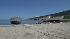 Fishing boats at the beach in skala marion, Thassos, Greece Stock Footage