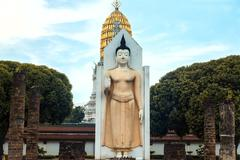Standing buddha image in the temple. Stock Photos