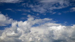 White clouds running over blue sky. Timelapse - stock footage