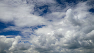 Stock Video Footage of White clouds running over blue sky. Timelapse