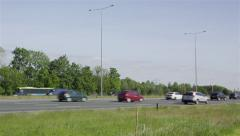 Traffic moving on a sunny afternoon Stock Footage