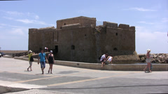 Medieval fort in Paphos with people walking past Stock Footage