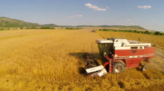 Harvesting wheat aerial view - stock footage
