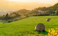 Stock Photo of farmhouse in tuscany located on a hill
