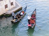 Stock Photo of two gondolier rides gondola on the grand channel