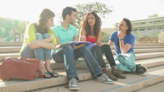 Static close up of four students doing home task outdoors Stock Footage