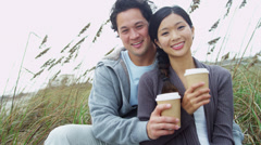 Laughing Ethnic Male Female Keeping Warm Outdoors Beach Stock Footage