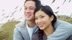 Young Ethnic Couple Warm Clothing Close Up Fall Beach Vacation Stock Footage