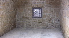Interior view of Paphos castle with stone walls and arched ceiling Stock Footage