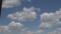 Clouds on blue sky moving slowly, clear sunny day, lack of rain, summer scene Stock Footage