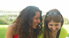 Two best friends enjoying themselves laughing outdoors Stock Footage