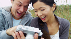Attractive Young Asian Chinese Couple Using Camera Outdoors Fall Stock Footage