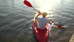 Guy sailed from the pier on the sport kayak - recreational aktivity kayaking Stock Footage