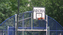 Basketball arena for children in playground, closeup balls going through basket - stock footage