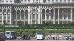 Tourists in Parliament building square, tourism at biggest european construction Stock Footage