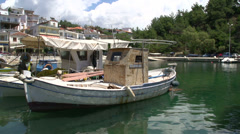 Pan from Fishing boats in limenaria harbor thassos greece Stock Footage