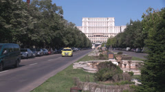 Street to Parliament landmark, yellow cabs and cars on boulevard in summer day Stock Footage