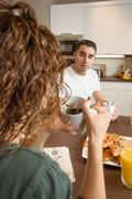 serious couple with problems speak at breakfast - stock photo
