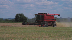 Combine harvester working on wheat field - stock footage