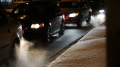 Exhaust fumes on a cold winter night Stock Footage