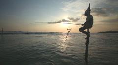 GALLE, SRI LANKA - MARCH 2014: Silhouette of elderly fisherman. Stock Footage