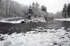 Fresh Snow on Riverbank - stock photo