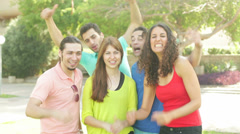Education concept - group of smiling students standing and waving hands Stock Footage