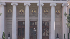 Entrance in Romania Athenaeum, nice columns and paintings on walls, architecture Stock Footage