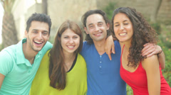 Friends of four posing for a picture Stock Footage