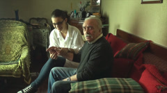 Stock Video Footage of 80 Years Old Man Checked Up, By His Medical Student Grand Daughter, Arthritis