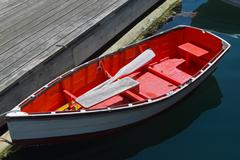 Small Red Row Boat - stock photo
