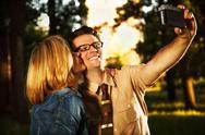 Stock Photo of Caucasian young adults in park at sunset