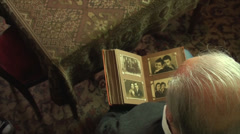 80 Years Old Man, Looking In An Photo Album, Memories, Family, Above Shot Stock Footage