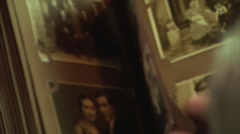 Stock Video Footage of 80 Years Old Man,Looking In An Photo Album, Memories,Family, Above Shot Zoom Out