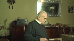 80 Years Old Man, Looking In An Photo Album, Memories, Family, Nostalgic, Tilt Stock Footage