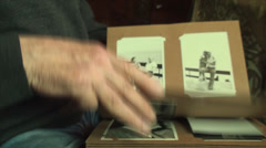 Stock Video Footage of 80 Years Old Man Hand Detail, Flipping Photo Album, Nostalgic, Arthritis, Family