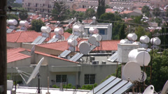 Houses with solar hot water tanks on roofs Stock Footage