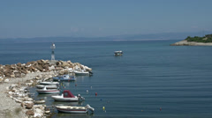 Fishing boats in small harbor in skala marion Thassos Greece Stock Footage