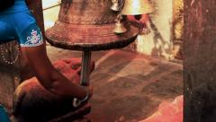 A young woman rings a bell in a Hindu Vaisnava temple. - stock footage