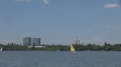 Adventure on water, summer sports, sailing boat small size on lake, park view Stock Footage