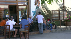 Street scene with local people in skala marion Thassos Greece Stock Footage