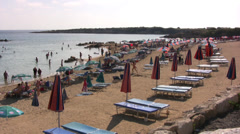 Beach at Coral Bay near Paphos with sunbeds and parasols Stock Footage