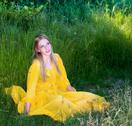 Stock Photo of beautiful woman in yellow dress posing in nature