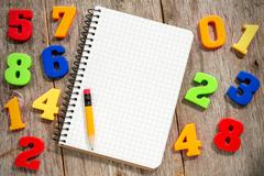 Stock Photo of colorful numbers and empty notebook