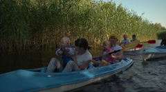 Family goes kayaking - aktive holidays Stock Footage
