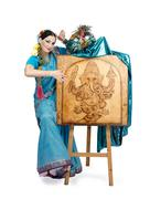 artist posing next to easel with pyrography lord ganesha - stock photo