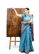 Stock Photo of artist in indian sari posing with pyrography painting lotus
