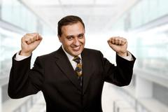 Successful business man with open arms, at the office Stock Photos