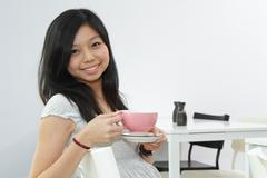 woman with coffee - stock photo