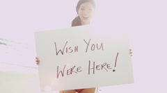 Smiling Young Ethnic Female Close Up Holding White Message Board Stock Footage